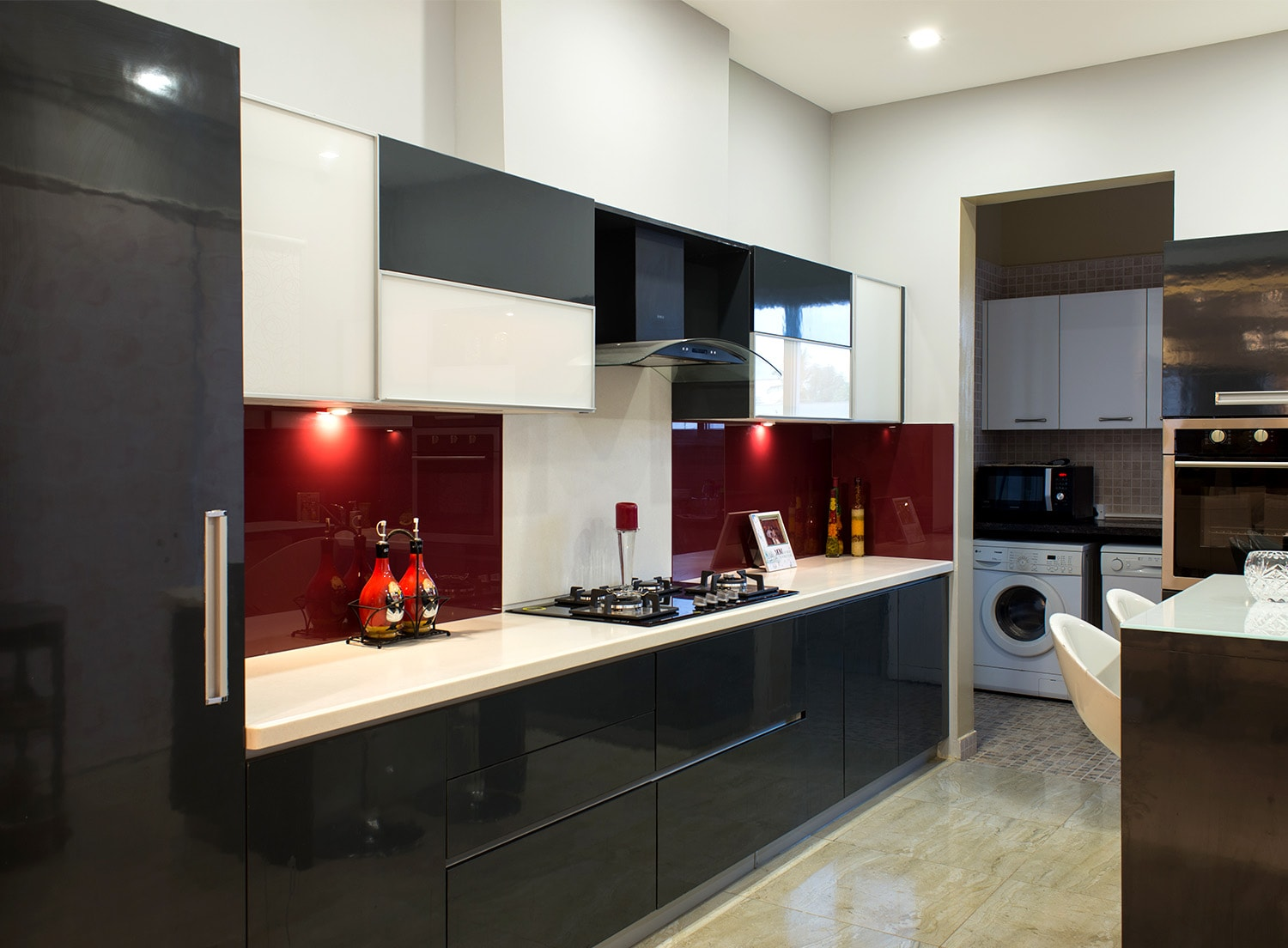 Home interiors by homelane modular kitchens wardrobes for Sample modular kitchen designs